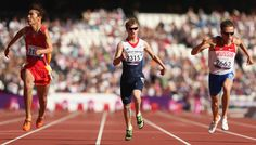 Rhys Jones of Great Britain competes in the Men's 100m T37 heats wearing blue kinesiology tape.