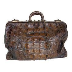 Cuban Crocodile Doctor's Bag Early 1900's. Beautiful crocodile doctor's bag from the early 1900's, with key and lock intact from www.dosgallos.com