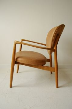 Ib Kofod Larsen tan leather armchair