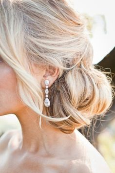 low, loose chignon #wedding
