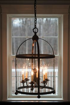 A warm glow radiates from this striking chandelier. Cobblestone Homes: lighting fixtures, SW69. Follow link for the photo gallery of the full home.