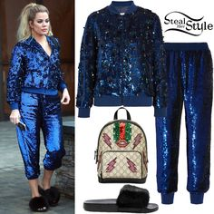 Khloe Kardashian was spotted leaving a studio in Calabasas wearing a Sequin Embellished Bomber Jacket ($870.00) and Sequin Embellished Zip-Seam Silk Trousers ($676.00) both by Ashish, a Gucci Beaded Sky GG Supreme Backpack ($2,690.00) and The Confetti Boutique Confetti Fox Slippers ($110.00). You can find a similar jacket at Boohoo ($49.00) and similar slides at River Island ($44.00).