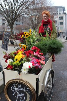 """""""I'm the country's only florist on bike. I can pull up to a place if I have all my supplies and I can do a wedding off of this. I know how to work free hand.""""  """"Why did you choose bike?""""  """"Because I don't know how to drive a car.""""  """"I'm glad I met you riding around town today!""""  """"Well, I was having a little bit of difficulty being motivated to leave the store today, but then I remembered that we are all apart of Portland's fabric.""""  #pdx #pplofpdx #bike #cargobike #innovation"""