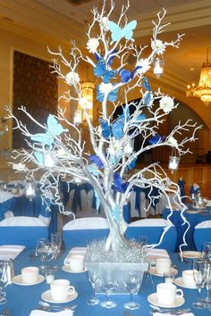 Silver Tree Centerpiece Silver Tree Centerpiece with Blue Butterflies & Hanging Tea Lights Butterfly Centerpieces, Tree Centerpieces, Butterfly Decorations, Wedding Centerpieces, Wedding Decorations, Christmas Decorations, Cinderella Centerpiece, Table Decorations, Butterfly Party