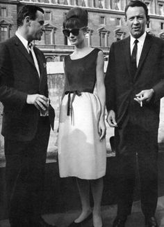 """The actress Audrey Hepburn photographed between Jack Lemmon and William Holden in the boat """"Bateau Mouche"""" on the Seine after a press conference for the publicity of her new movie """"Paris When It Sizzles"""". Paris (France), July 13, 1962. -Audrey was wearing a creation of Givenchy."""