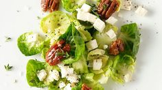 """NYT Cooking: This recipe came to The Times by way of Amy Lawrence, and her husband, Justin Fox Burks, who developed it for their blog, the Chubby Vegetarian. The trick to this salad is to blanch the brussels sprouts in salty water to remove the bitterness. The candied pecans combined with smoky feta creates a heavenly dish. """"Even the little kids eat it,'' said Ms. Lawrence."""