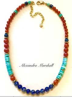 "You have many options with this gemstone (Lapis, Coral, Carnelian, and Turquoise Magnesite) necklace by Alexandra Marshall. The single strand makes a simple statement with jeans and a tee; but it can also be layered with chains and additional gemstone necklaces to make a dramatic accent for dressier attire. 18"" long plus 3"" extender chain. #N2567."