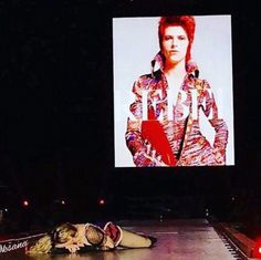 Madonna paid an emotional on-stage tribute to an inspiration of hers on Tuesday night.  She sang out David Bowie's Rebel Rebel to audience goers on her Rebel Heart tour in Houston, Texas before collapsing in a heap, overwhelmed by her sadness at his passing on Sunday.  The 57-year-old remembered the musician, 69, after saying she'd been 'devastated' by the news that he had lost his secret battle with cancer this weekend.