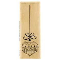 """Add a little holly jolly to your stamping supplies with Hanging Ornament Rubber Stamp. Featuring a design carved into pink rubber, this stamp is perfect for adding color and personalization to your crafts and projects. Use with any color ink pad (sold separately)--or combine ink colors for a bonus effect.        Dimensions:    Wood Block:      Length: 3""""    Width: 1""""    Depth: 3/4""""          Rubber Shape:      Length: 2 3/4""""    Width: 1"""""""