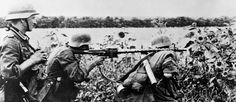 A German MG 34 machine gun team in action. The MG 34 and the later MG 42 were the best light machine guns of the war. Their fast rate of fire - up to 1,500 rounds per minute for the MG 42 - had a devastating effect on advancing Allied infantry. MH 12789.