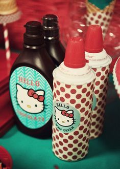 Hello Kitty make your own sundae station! DIY Hello Kitty labels for whipped cream and chocolate sauce will make a truly sweet and memorable birthday party.