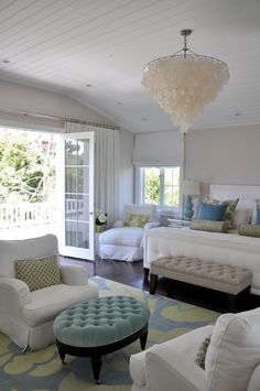 Coastal Living. I want my bedroom to have windows that open up like that.