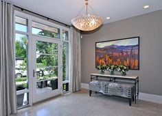 Arched windows, French doors and sidelights get their due with treatments that keep their beauty out in the open