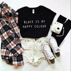4. Black statement crop top and ripped white jean shorts, with black knee highs going into white low cut Converse All Stars, and a plaid shirt thrown over the top