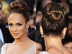 Normally when people talk about J.Lo's big bun, they're referring to something else. But this time it was her sleek, oversize updo – pulled taut off her face to reveal her flawless complexion and smoky eyes – that turned heads.