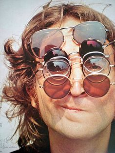 Portrait of John Lennon of The Beatles, wearing a stack of sunglasses. Ringo Starr, George Harrison, John Lennon Sunglasses, Foto Poster, Les Beatles, Beatles Quotes, John Lennon Beatles, Beatles Songs, Musica Popular