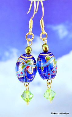 Bright blue hand painted gysy beads on gold plated ear wires by Eleksmom Designs.