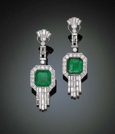 A FINE PAIR OF EMERALD AND DIAMOND EAR PENDANTS   Each set with a square-cut emerald to the circular-cut diamond frame to the baguette-cut diamond tassels and baguette and circular-cut diamond surmount, mounted in platinum. American Gemological Laboratories reports mild enhancement using Canadian Balsam type treatment, indicating  early 20th century in age. [Assumed to be Art Deco.]