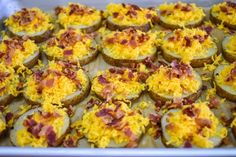 These baked potato slices topped with melted cheddar cheese and crispy, crumbled bacon make a great appetizer or side dish. This recipe is a fun take on a loaded baked potato. They're simple to make and budget friendly. Baked Potato With Cheese, Baked Potato Slices, Sliced Potatoes, Loaded Potato Salad, Bacon In The Oven, Great Appetizers, Fresh Herbs, Cheddar Cheese, Cheddar