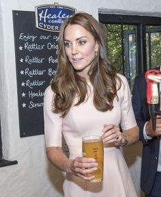 """Kate handed the pint to William who joked """"I'll fall over if I drink that."""""""