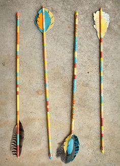 colorful feather arrows. don't know what I'd do with them, but they sure look cool.