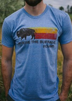 """Men's graphic tees by Buffalo Jackson Trading Co. are super soft for that worn, broken in, vintage Urban Outfitters style. Keep fashion simple: these shirts are perfect for men wanting a go-to, comfortable outfit. We're all about helping you guys keep it cool (and casual) this summer. Lots of awesome t shirt designs available — our retro """"Where The Buffalo Roams"""" tri-blend (poly / cotton / rayon) crew neck tee (for the adventure lover) shown here."""