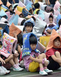 Japanese Children in Safety Hoods.