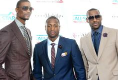Smartly suited players Chris Bosh, left, Dwyane Wade and LeBron James attend the 2011 NBA All-Star game at L.A. Live in February. (Jason LaVeris / FilmMagic)