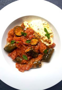 Slow-Cooked Courgettes & Cherry Tomatoes with Melty Feta Wheels #vegetarian #zucchini #cheese #tomatoes #vegetarianrecipes