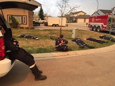 Exhausted fire fighters rest after battling Fort McMurray (Alberta, Canada) wild fires for 30 hours straight. May, 2016.