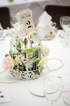 Wedding Inspiration → Pearls Birdcage centerpiece with flowers and pearls. | Whimsical Wonderland Weddings