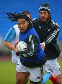 Maa Nonu of the All Blacks is held by Rene Ranger during a New Zealand All Blacks training session at Trusts Stadium on June 4, 2013 in Auckland, New Zealand.