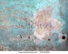 Composition with old and weathered painted wall and rusty pipe at the bottom of the image. Natural colors and light / Wall and Hole / Havana, Cuba.