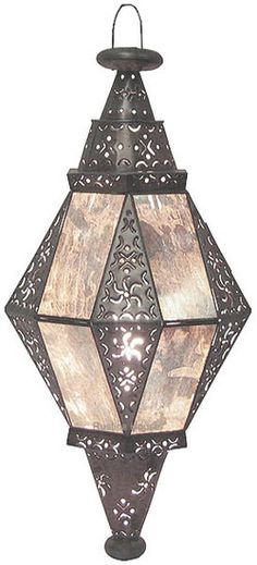 The Diamante Lantern provides a soothing ambient lighting effect from all sides. Handmade in Mexico with great quality and care, this lantern's impact on a room is both calming and alluring. Moroccan Lighting, Moroccan Decor, Hanging Lanterns, Candle Lanterns, Candles, Ceiling Lamp, Ceiling Lights, Mexican Furniture, Charro