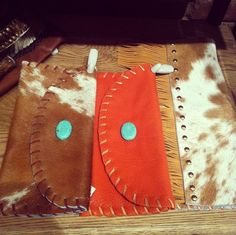Cowhide clutches.