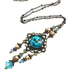Features:  Swarovski Elements Light Turquoise Rivoli Crystal Pendant w/dangles measures approx. 2 inches long Swarovski Bronze 6mm Pearls