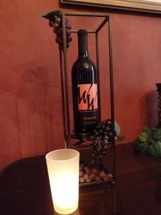 Framework pillar holder with wine www.partylite.biz/marybacon. Retiring 12/15/13. Don't miss out.