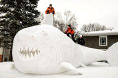It took three brothers about 95 hours to build this 16-foot-high snow shark in the front yard of their New Brighton, Minn., home.