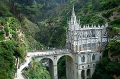 In the mountains of southwestern Colombia, the Cathedral of the Virgin of Las Lajas ranks among the most enchantingly beautiful pilgrimage shrines in the world. The sanctuary of Las Lajas is a neo-Gothic cathedral which was built between 1916 and 1944 to Oh The Places You'll Go, Places To Travel, Places To Visit, Travel Destinations, Beautiful Buildings, Beautiful Places, Simply Beautiful, Famous Castles, Chapelle
