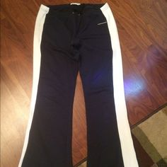 Abercrombie track pants Navy blue with white stripes, stretchy material. Used but great condition! Abercrombie & Fitch Pants Track Pants & Joggers