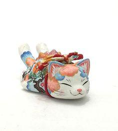 Artist: Konatsuya  Title: Sleeping Negora  Medium: Water color  &  Traditional Japanese paper on vinyl  Size: 4″