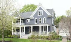 Siding BM Midnight Blue (slightly faded) / Trim OC-85 Mayonnaise. Navy Blue Exterior - Maria Killam