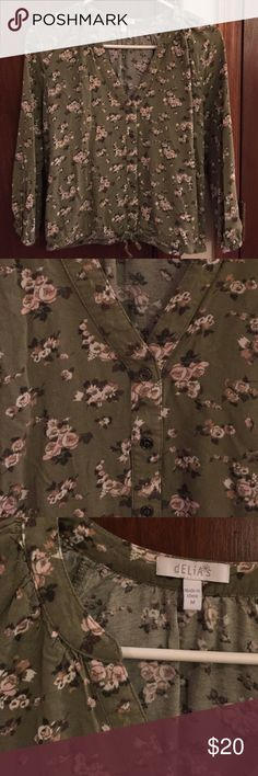 Green Floral Blouse Adorable 3 quarter length sleeve blouse with a light pink floral pattern! It has buttons down the front with a tie at the bottom. Super great for year round wear! Only worn a few times, so in excellent condition ❣️Purchased at Delia's Tops Blouses