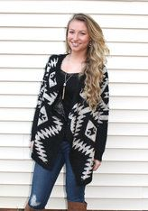 Cozy Knit Black and Ivory Tribal Print Cardigan Maybe the softest and coziest cardigan ever! Its thick knit is sure to keep you warm. The tribal pattern is very on trend without being overly trendy. Get this sweater early...and wear it often! White Barn Boutique