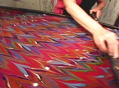 Transfer paint onto white silk scarves to create an attractive marbled silk scarf. Learn how at HGTV.com.