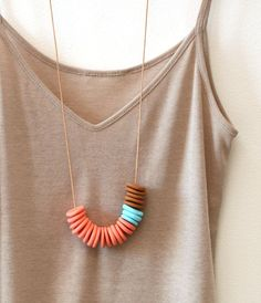 polymer clay beads. love these colours together: beige, ocher, coral, and light turquoise.