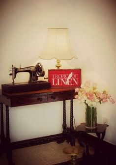 Antique sewing machine at Tropic Of Linen Boutique. Retail Shop Interior design. TropicOfLinen