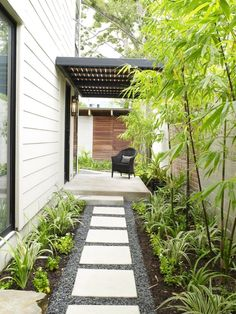 SQUEEZE PLAY: Landscape architect Rita Hodge added tall black bamboo and lower-g., SQUEEZE PLAY: Landscape architect Rita Hodge added tall black bamboo and lower-growing perennials to soften this narrow, vertical entry. Side Yard Landscaping, Landscaping Ideas, Modern Landscaping, Landscaping Software, Landscaping Company, Black Rock Landscaping, Pebble Landscaping, Landscaping Contractors, Landscaping Melbourne