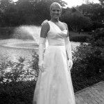 #RealBride wearing a one-shoulder custom heidi elnora wedding dress for her romantic outdoor wedding!
