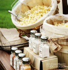 Popcorn bar... So cute! And so cheap! Pick up a bag before the wedding begins and have a snack during the ceremony!